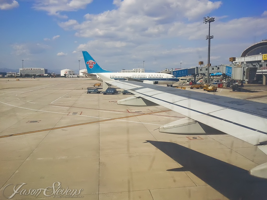 Beijing Airport Wing View From China Eastern A321 With China Southern 737-700 B-5239 Nextdoor