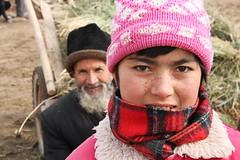 Girl and grandfather in the sunday bazaar village, near Kashgar (inchiki tour) Tags: china travel winter people photo village market uighur xinjiang silkroad kashgar   uyghur bazaar centralasia