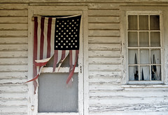 Tattered (The Goat Whisperer) Tags: rural sad decay flag american worn torn decrepit tattered