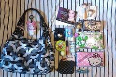 What's in my bag? (Skellington15108) Tags: skellington15108 coach madison coin case secret flawless renewal hello kitty pink tokidoki elf eyes lips face lip gloss lipgloss tin craze coconut juicy couture wallet steel grey gray victorias mint pill box eos chapstick mirror pouch smashbox purell nars cosmetics orgasm cutter boxcutter coupons my melody build bear eco tools mini brush set ecotools whats bag purse