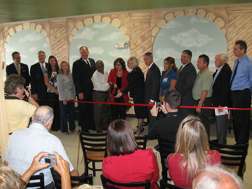 "Lee County Commissioner Tammy Hall cuts the ribbon at Ft Myers Salvation Army's Grand opening of ""Sally's Cafe"""