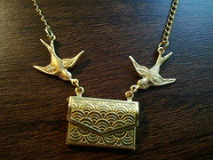 gold swallow necklace with envelope pendant