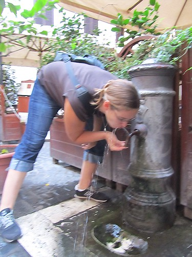 Sarah drinking from Roman fountain