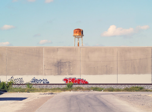 graffiti with distant water tower