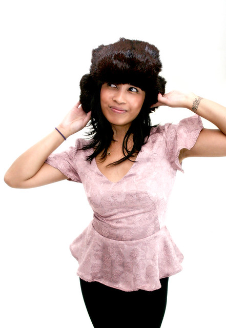 Jess in Deco Modiste Orchid peplum top + Sustalux trapper hat