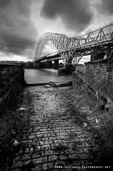 My Nemesis (Lee Carus) Tags: street bridge urban cloud brick weather wall architecture river mono cheshire decay sony litter cobbles mersey runcorn widnes a55 slta55v