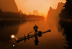 The Li River (Stuck in Customs) Tags: china morning travel sun mist fish digital sunrise photography boat early blog high fisherman october asia republic dynamic stuck guilin east photoblog software processing imaging raft prc rise  range brilliant hdr tutorial trey travelblog zhuang customs 2010 guangxi  lijiangriver  ratcliff hdrtutorial stuckincustoms treyratcliff guangxizhuang  ljing photographyblog peoplesrepublicofchina stuckincustomscom nikond3x  zhungz boucue  gveilinz soetop50spotsfordaydreamers