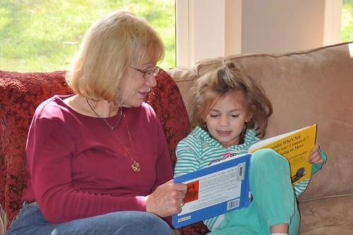 Alana reads with J