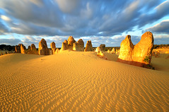 Pinnacles Desert (Nora Carol) Tags: landscape sand desert patterns australia limestone cervantes westernaustralia rockformation movingclouds pinnaclesdesert nambungnationalpark noracarol hoyandx400 bizzareplace lpbest2010
