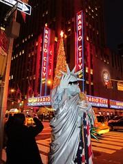 She's a Lady (a nameless yeast) Tags: newyork manhattan midtown statueofliberty radiocitymusichall
