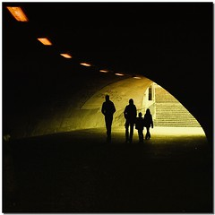 The light guide of family (Nespyxel) Tags: life family light people black berlin yellow backlight germany deutschland gallery famiglia arc silhouettes tunnel persone giallo arco nero luce galleria germania controluce berlino sagome mywinners lightguide superlativas absolutegoldenmasterpiece truthandillusion