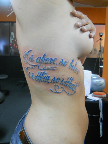 Tattoo Blue Text on Women Waist
