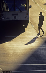 """Silhouetted youth crossing street toward sunset along """"The Ave"""" in the University District Seattle, Washington State USA (Jim Corwin's PhotoStream) Tags: silhouetted silouettes man male boy youth youthful child childhood summer leisure leisureactivity sunset urban urbanscene downtown street streetscene mystery twopeople quiet peaceful solitude individual individuality lonely photography vertical isolation single city cities dark mysterious shadowyfigure intersection universitydistrict seattle lifestyle crosswalk cars"""