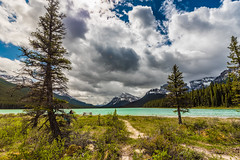 Glacial Lake picnic spot (tibchris) Tags: banff banffnationalpark canada outdoors nature clouds glacial lake trees mountains travel landscape turquoise