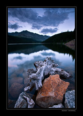 Rocky Shore (Koveh Photography) Tags: sunset lake mountains reflection canon eos colorado branch purple shore mayflower 1635 rockyshore ef1635 5dmkii