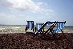 another sunny afternoon (Gerbera.) Tags: uk blue sea england brown white green beach weather glitter clouds pier seaside brighton chairs wind stripes south united side kingdom sunny pebbles blow deck shore breeze
