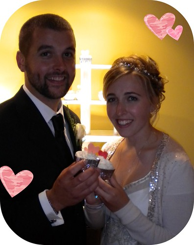 bride and groom with cupcake