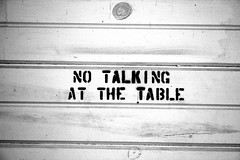 Sign above table in dining car (blossomdawes) Tags: bw sign notalking cassscenicrailway