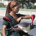 Uyghur woman on moped