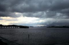 Heavy Sky at Loch Lomond (Dun.can) Tags: light sunset sky lake storm water clouds scotland pier loch lochlomond luss guesswhereuk gwuk