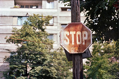 (Yellow Bear) Tags: street film sign 35mm lens nc kodak pole flats stop romania balconies roadsign zenit analogue manual portra bucharest wildwest 160 44mm bucureti