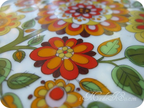 orange floral motif print on dish