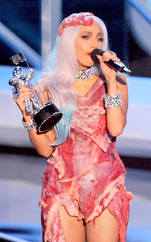 Lady Gaga with her award trophy wearing her Meat Dress copied from The Beatles' 'Yesterday and Today' album cover