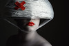 Day Three Three Three (Lou Bert) Tags: red portrait white black art wool girl face make up hat self paint helmet band makeup plaster yarn aid cotton lipstick facepaint