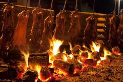 Porceddu in cottura (Roberto_Ventre) Tags: sardegna sea sky italy color beach cooking colors fire pig seaside italia mare sardinia cook colori posada spiaggia fuoco sagra porceddu