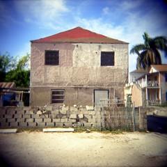 good fences (t. magnum) Tags: holga nassaubahamas cinderblockwall concretehouse bahamas2010