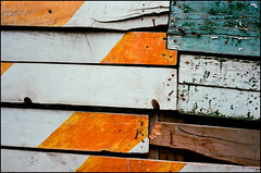 distressed wood #15 - tbilisi (chirgy) Tags: wood red orange white green texture georgia paint scan hoarding nails faded transit planks tbilisi reconstruction fujisuperia1600asa voigtlanderbessar snappysnaps თბილისი საქართველო autaut granin hotelvip jupiter850mm12