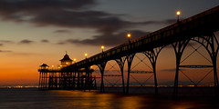 Nightfall At Clevedon Pier (Andy Brown (mrbuk1)) Tags: ocean sunset shadow panorama seascape reflection water architecture clouds dark lights mood victorian atmosphere somerset severn colourful drama redskyatnight bristolchannel bestcapturesaoi elitegalleryaoi