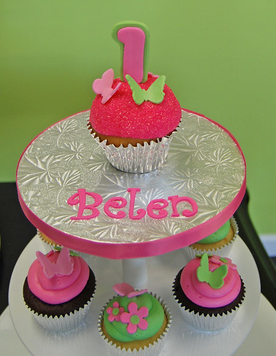 pink and green 1st birthday cupcake tower with butterflies and flowers