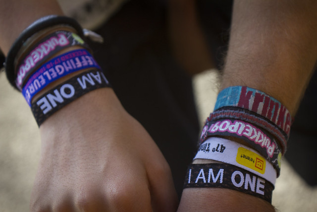 A new ONE member shows off their wristbands