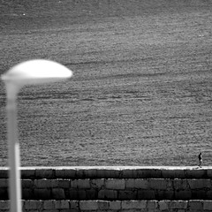 Oceans of uncertainty (cctrilla) Tags: sea blackandwhite bw music man byn blancoynegro port puerto mar farola mediterranean mediterraneo poem streetlamp olympus musica lonely poesia oceans solitario hombre breakwater peiscola rompeolas oceanos quiquegonzalez espigon cctrilla e520