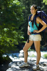 Young woman hiking in summer (KnightWolf Photography) Tags: park travel summer people woman tree green nature girl beautiful grass sport female trekking river way landscape person waterfall cool healthy movement colorful view action outdoor map hiking path walk young meadow free lifestyle sunny hike adventure trail backpacking harmony backpack hiker recreation activity fitness backpacker exercises vacations compass active freash driking