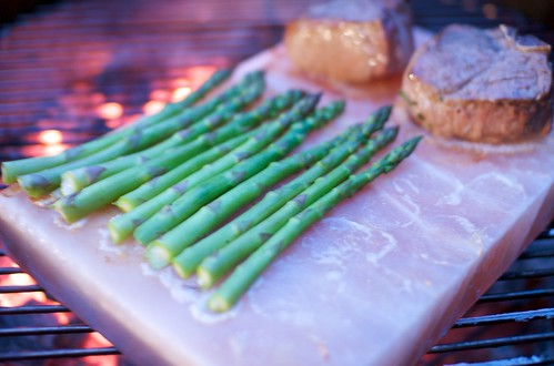 asparagus and lamb grilling on salt block