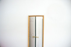 a mirror and two doors (scott w. h. young) Tags: door light white film wall mystery mirror imagination
