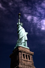 Liberty Enlightening the World 0605 (casch52) Tags: world new york light ny face statue canon liberty freedom harbor photo election darkness political free icon torch photograph statueofliberty vote defiant pedestal enlightening 50d