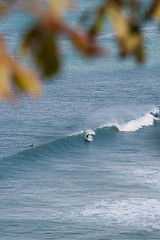 Sheltered (malpractice) Tags: ocean blue sea water surf waves surfer wave surfing spray surfboard swell