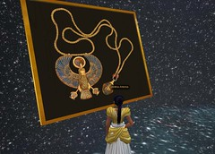 Meritaten examines royal pectoral in the Cosmic Gallery of virtual Amarna (Akhetaten) (mharrsch) Tags: gold kingtut ancient egypt jewelry 18thdynasty nefertiti akhenaten tutankhamun virtualworld pectoral meritaten amarna virtualenvironment mharrsch akhetaten heritagekey