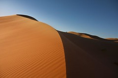 Erg Chebbi -   (GERMANO ZUCCA) Tags: world life trip travel blue sunset summer sky orange sahara sunrise canon desert dunes dune august adventure explore camel morocco marocco zucca deserto sabbia merzouga germano erfoud marocain 450d germanozucca erchebbi 1585is