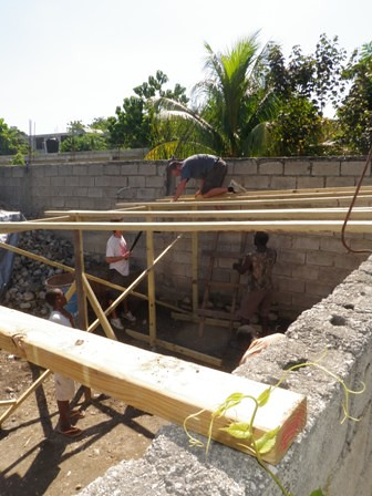 Day two of building a classroom for a free school at an orphanage The frame is up - so day to was all about the roof by EDV Media Director