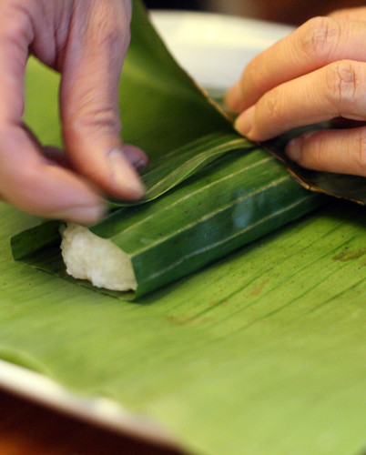 Preparing suman: wrapping the rice mixture