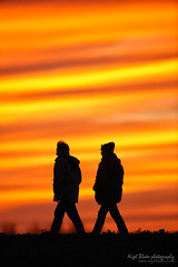 Walking on the sea wall at sunset (Nigel Blake, 13 MILLION...Yay! Many thanks!) Tags: uk friends sunset red sea people orange color colour colors yellow wall canon walking point fun photography eos coast day colours with time outdoor dusk norfolk perspective taken together end sharing leisure recreation activity blake nigel pursuit compressed daysend thornham 1dsmkiii 600mmf4is