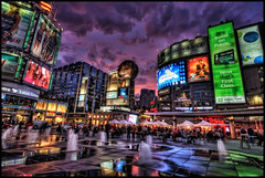 Toronto Yonge-Dundas Square (szeke) Tags: street city people urban toronto canada reflection building water fountain glass night clouds buildings landscape nightlights place citylights yongestreet hdr dundassquare 2010 noiseware photomatix nikcolorefex imagenomic colorphotoaward tumblr mygearandmepremium freakydeail