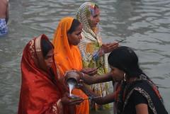 Offering Milk to Fasting Ladies (ramesh_lalwani) Tags: festival delhi hindu chhath