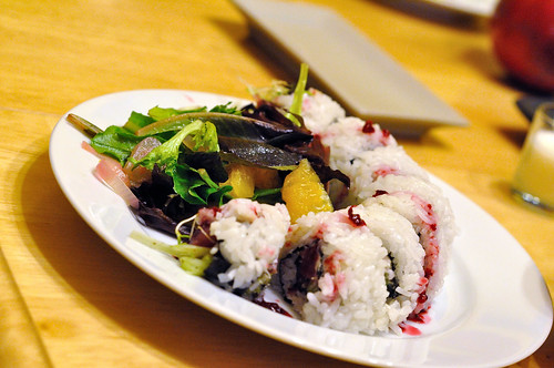 Pomegranate dressing salad, and sushi roll