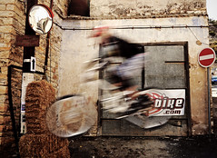 1st Lefkara Downtown Bike Race (ssj_george) Tags: road blur sports race lens lumix town jump movement ramp downtown village action hill helmet cyprus bikes down downhill panasonic event slowshutter biker pancake 20mm leap dmc blurring f17 gf1 lefkara ποδήλατα photographyblog κύπροσ georgestavrinos λεύκαρα ssjgeorge γιώργοσσταυρινόσ 1stlefkaradowntown sonyphotochallenge