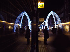 A Pair of Arches, South Molton Street, a man waiting in the shadows (Cybermyth13) Tags: christmas street xmas uk blue england white reflection london window dark lights evening waiting pair streetphotography 9 arches instruction 2010 londonist southmolton spnp